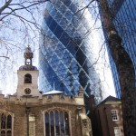"The contrast of old and new in the Financial district - the modernistic ""Gherkin"" building behind old St. Helens church."